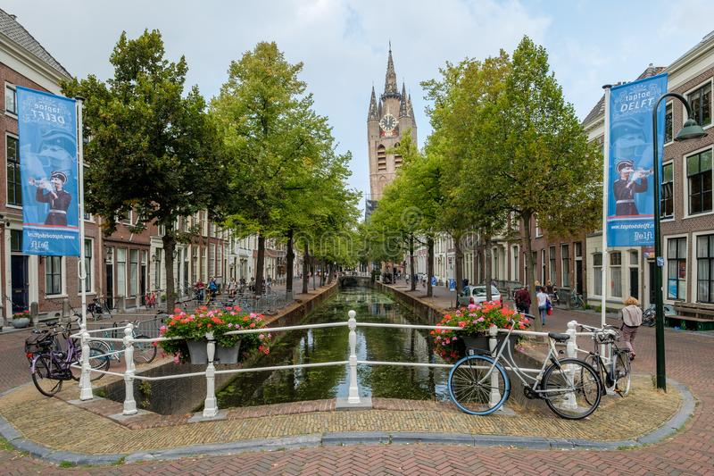 The oldest canal in Delft, Netherlands, with a view of the leaning tower of the Oude Kerk. royalty free stock photo
