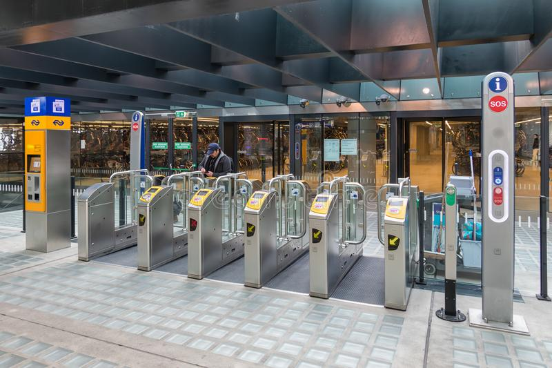 Chip gates at Delft central station for entrance railway platforms. Delft, The Netherlands - march 15, 2018: Chip gates at Delft central station for entrance to stock image