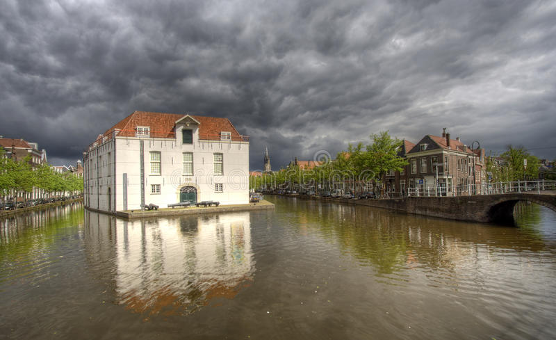 Delft View. Rainclouds over army museum in Delft, Holland royalty free stock photography