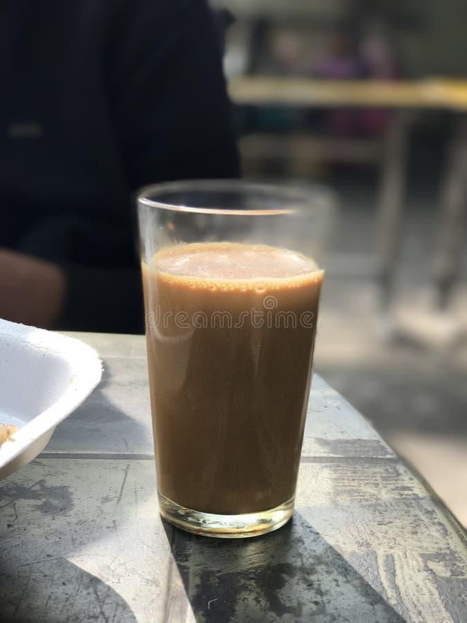 Glass of tea in delhi. Delhi early morning glass of tea royalty free stock image