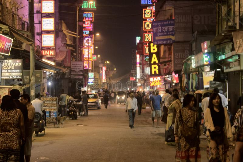 Delhi evening city on traditional street with old neon advertising. India, new Delhi - March 1, 2018: evening city on a traditional street with old neon royalty free stock photography