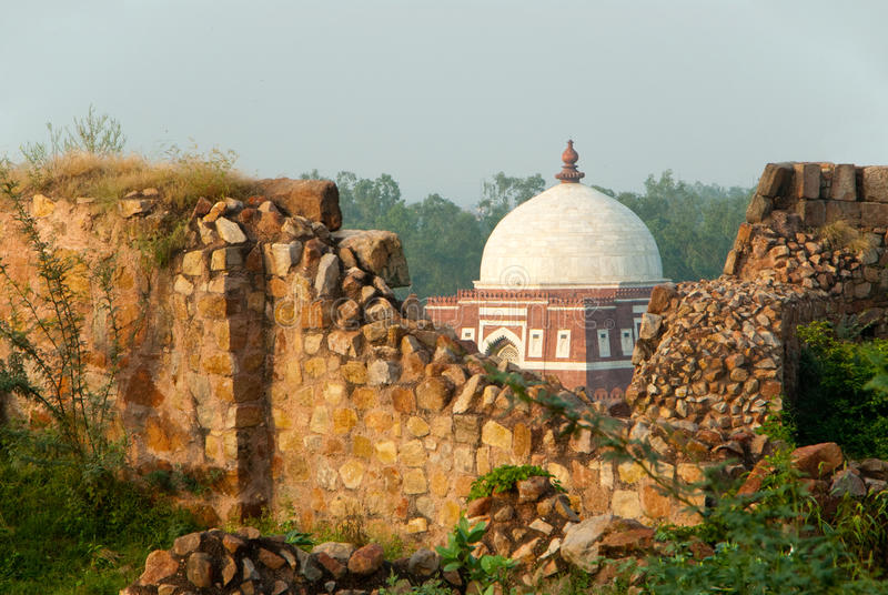 Delhi Fort. A Mughal tomb as seen from the ruins of the Tuglaqabad Fort in Delhi, India stock photos