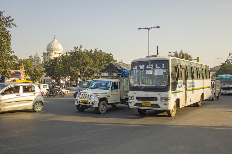 Indian white bus, moto and car traffic on city streets royalty free stock photography