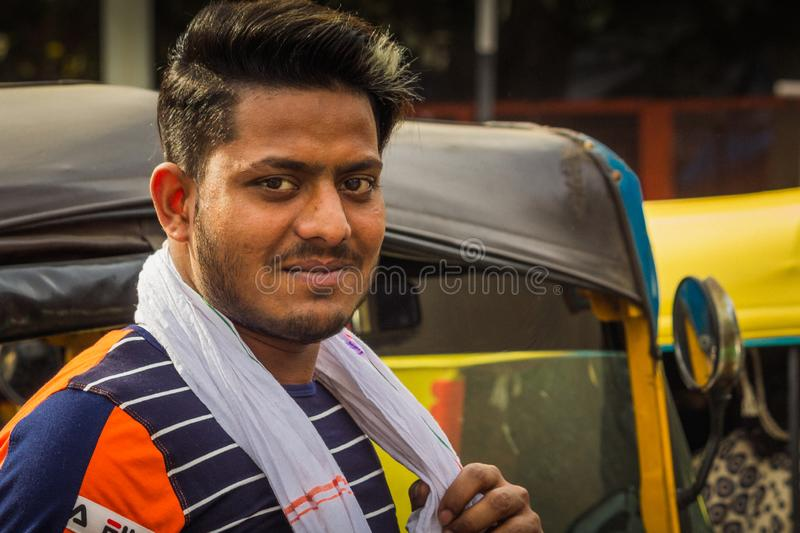 Delhi, India - March 19, 2019 : Indian auto rickshaw three wheeler tempo, taxi driver man royalty free stock photography