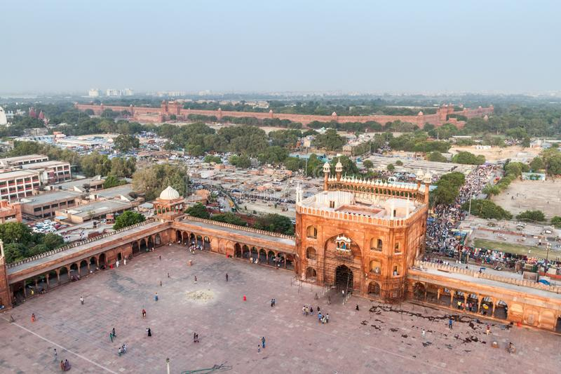 DELHI, INDIA - OCTOBER 22, 2016: Courtyard of Jama Masjid mosque in the center of Delhi, India. Red Fort in the. Background royalty free stock photos