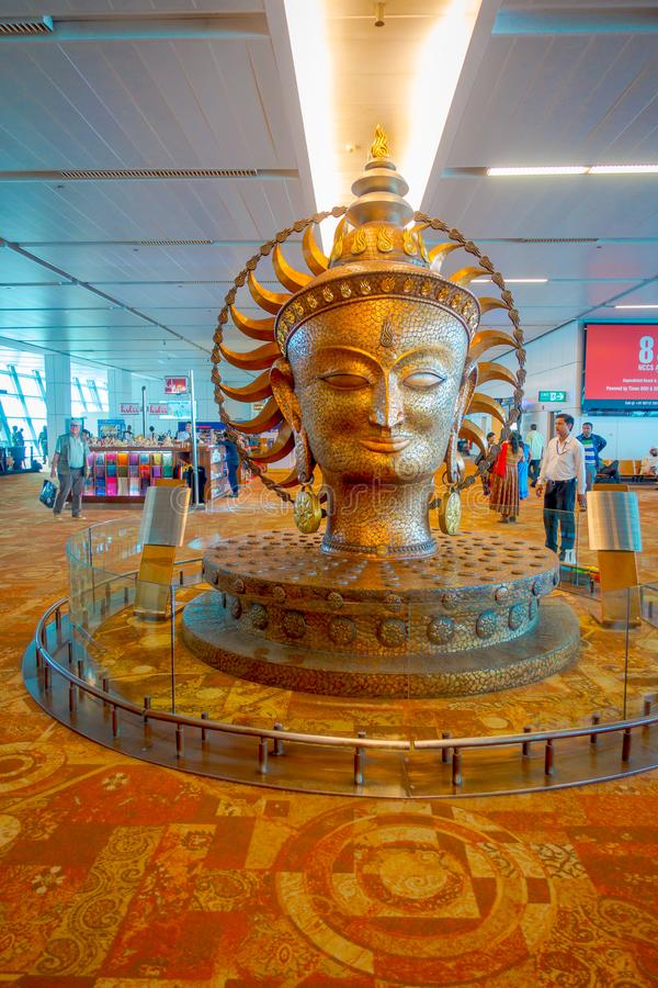 DELHI, INDIA - SEPTEMBER 19, 2017: The big golden statue in international Airport of Delhi. Indira Gandhi International stock photos