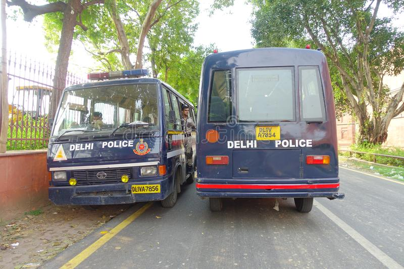 DELHI, INDIA - SEPTEMBER 25 2017: Two bus car police talking in the street in Delhi, the Indian capital.  stock images