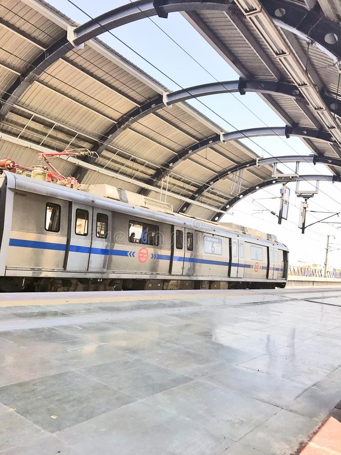 Delhi metro train at a less crowded metro station in New Delhi in the noon time stock images