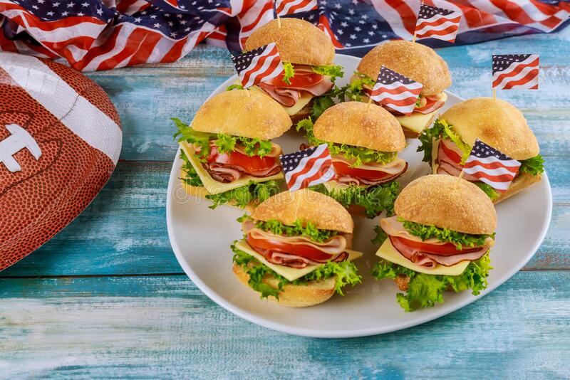 Deli cold sandwiches on plate for american football game party royalty free stock photos