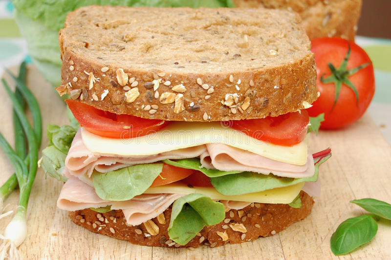 Deli sandwich. On a cuttingboard stock image
