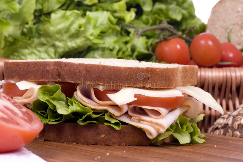 Deli Sandwich 3. A fresh deli sandwich with tomatoes swiss chees, lettuce and lots of meat stock image