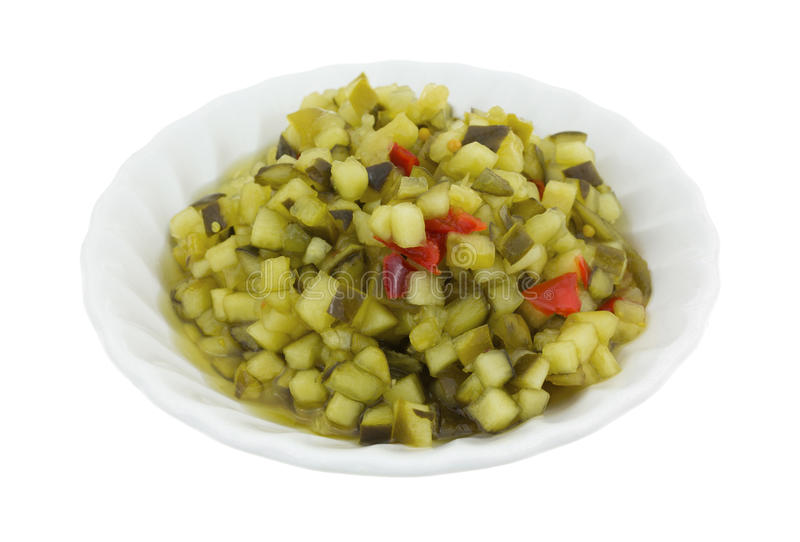 Deli style sweet relish in a small bowl. A small bowl of delicatessen style sweet relish isolated on a white background royalty free stock images