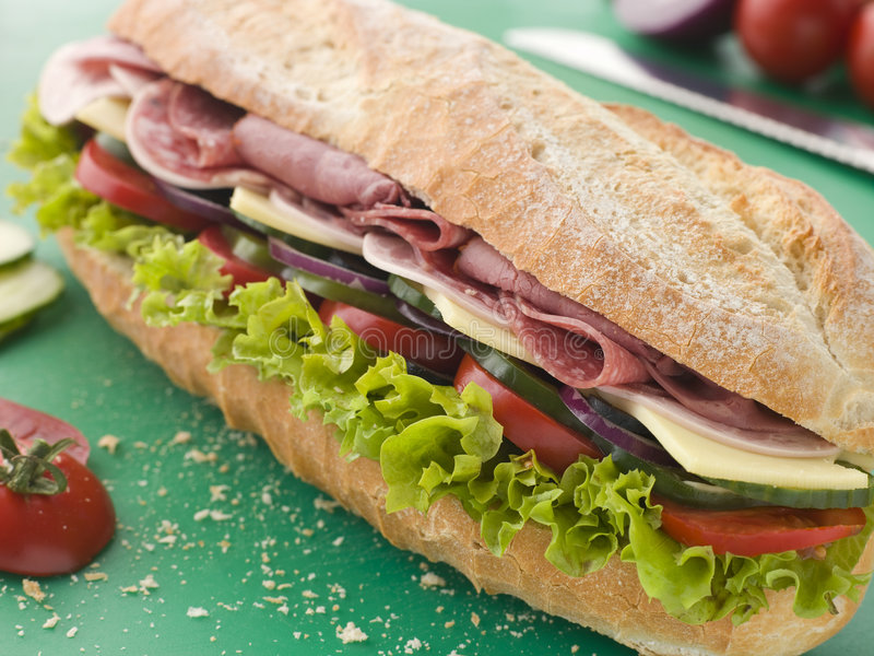 Deli Sub Sandwich. On a Chopping Board royalty free stock photography