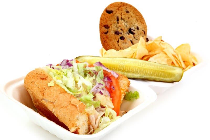 Deli Turkey Sandwich, Pickle, Chips, Cookie stock image