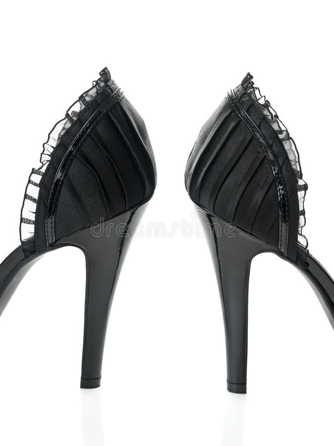 Delicate black laces high heels detailed view stock photos