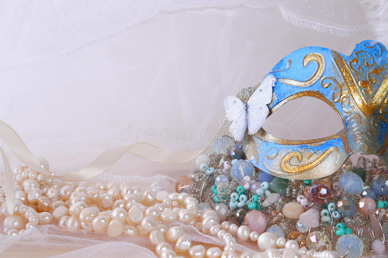 Download Delicate Blue Venetian Mask Next To Pearls And Jewel Stock Photo - Image: 83701901