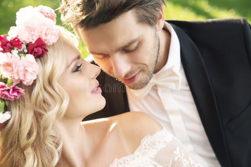 Delicate bride with handsome groom. Delicate young bride with handsome groom royalty free stock image