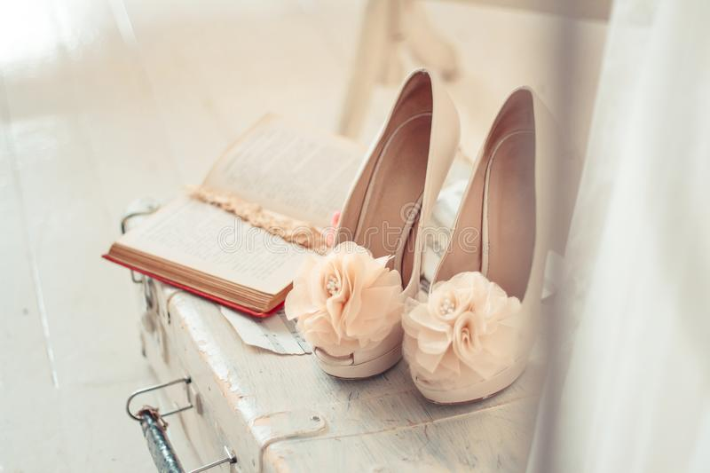 Delicate composition of wedding shoes and accessories decorated. In rustic style. Selective focus. Vintage toning royalty free stock photos