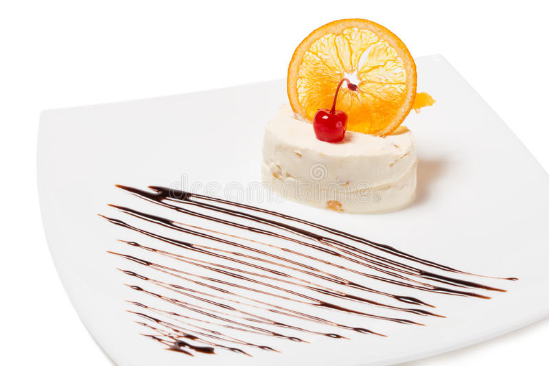Delicate cream dessert with orange. stock photos