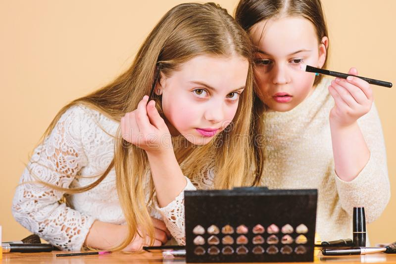 Delicate make-up emphasizing the beauty of the models. Small make-up artists. Little girls doing face painting and make royalty free stock photo