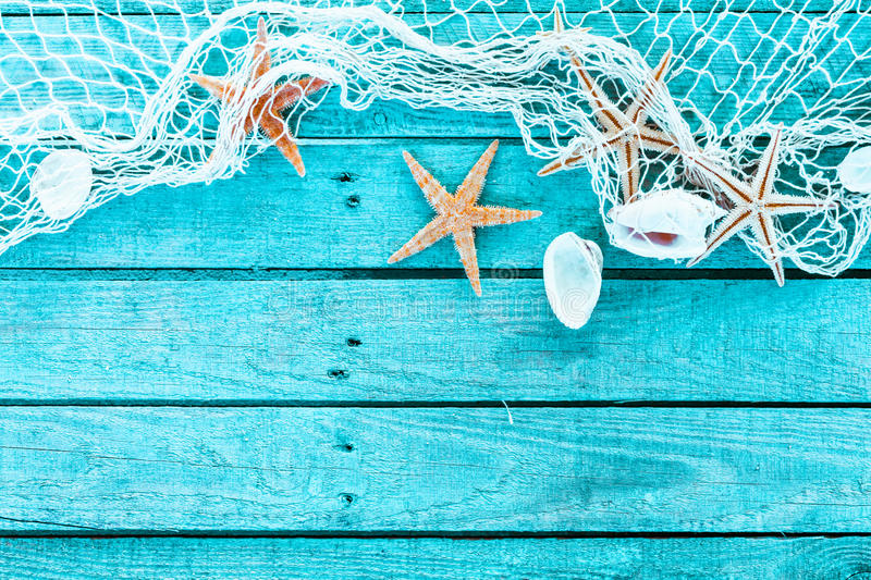 Delicate Marine Border Of Net, Shells And Starfish Stock Photo