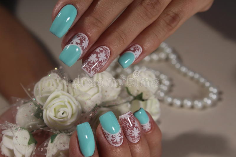 Delicate nails white with blue stock photography