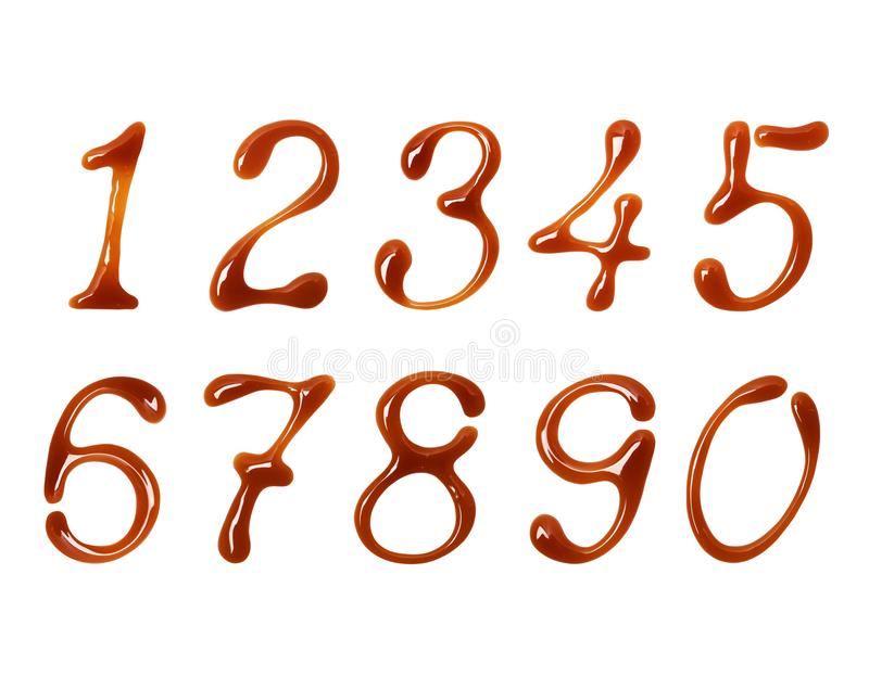 Delicate numbers made of caramel on white background.  stock photos