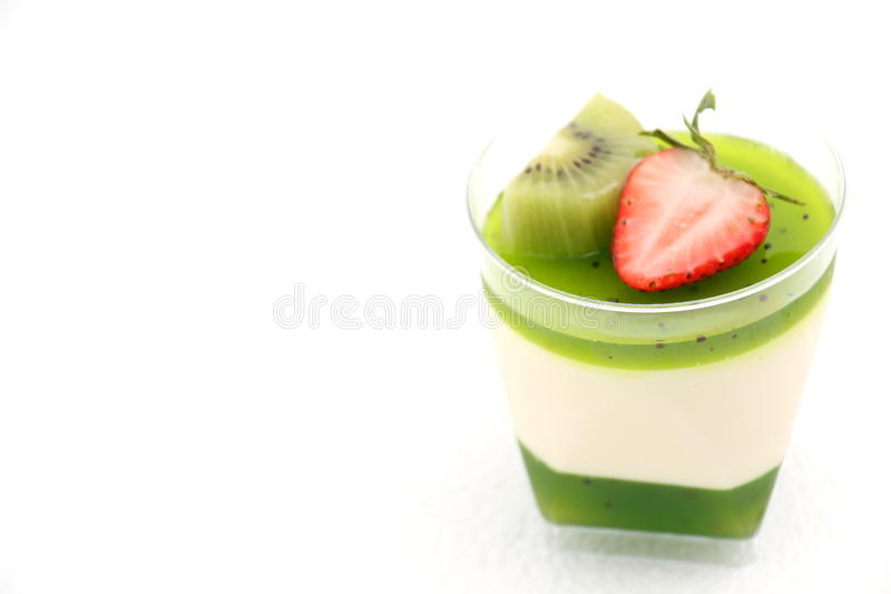 Delicate panacotta decorated with fresh fruit. stock photography