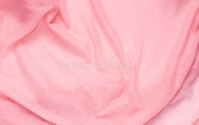 Delicate soft and wrinkled fabric pink color background texture royalty free stock images