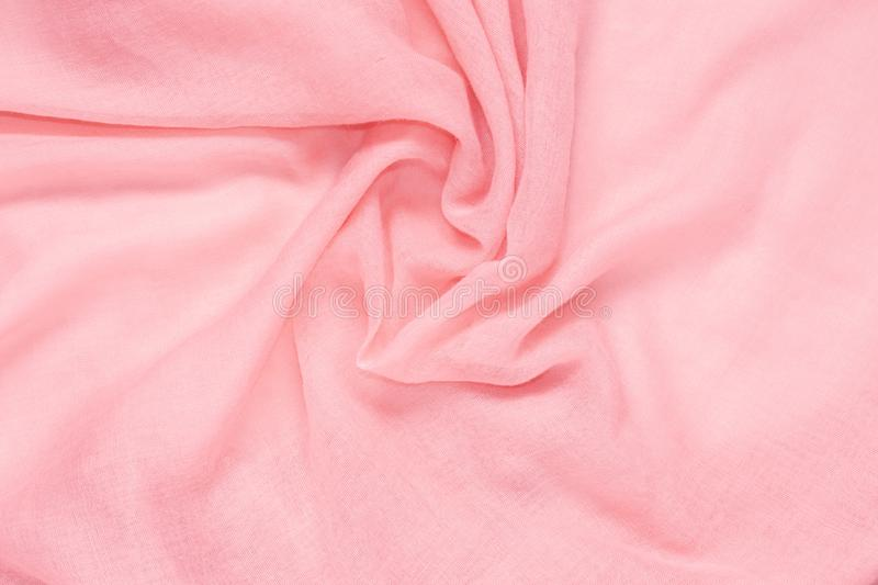 Delicate soft and wrinkled fabric pink color background texture stock images