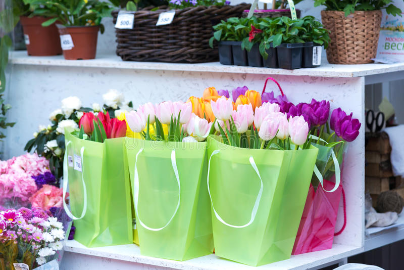 Delicate spring tulips in a gift bag on market royalty free stock photo