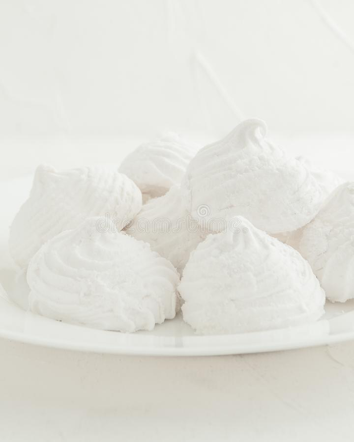 Delicate, white, fruit marshmallows On a white background in a white plate. stock photography