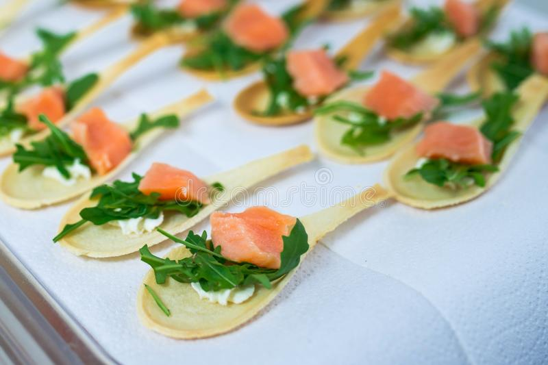 Delicates, appetizer filling with red fish and greens. Catering service. royalty free stock photos