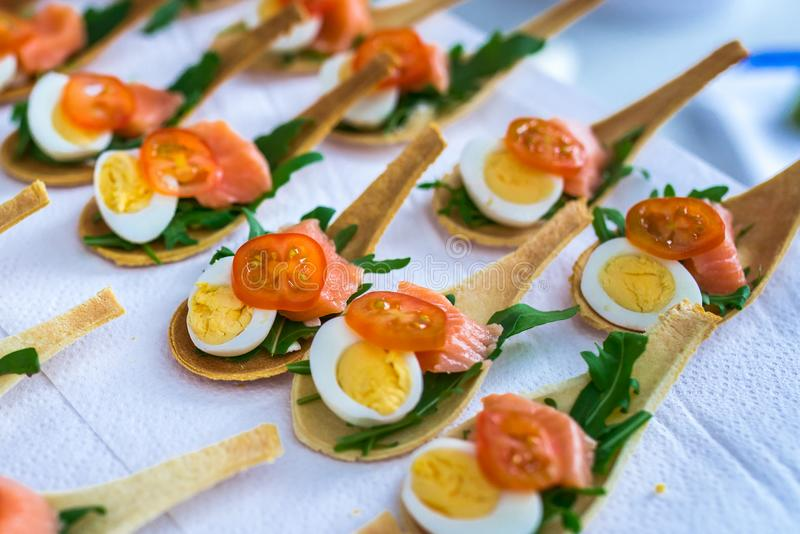 Delicates, appetizer filling with red fish and greens. Catring service. royalty free stock photo