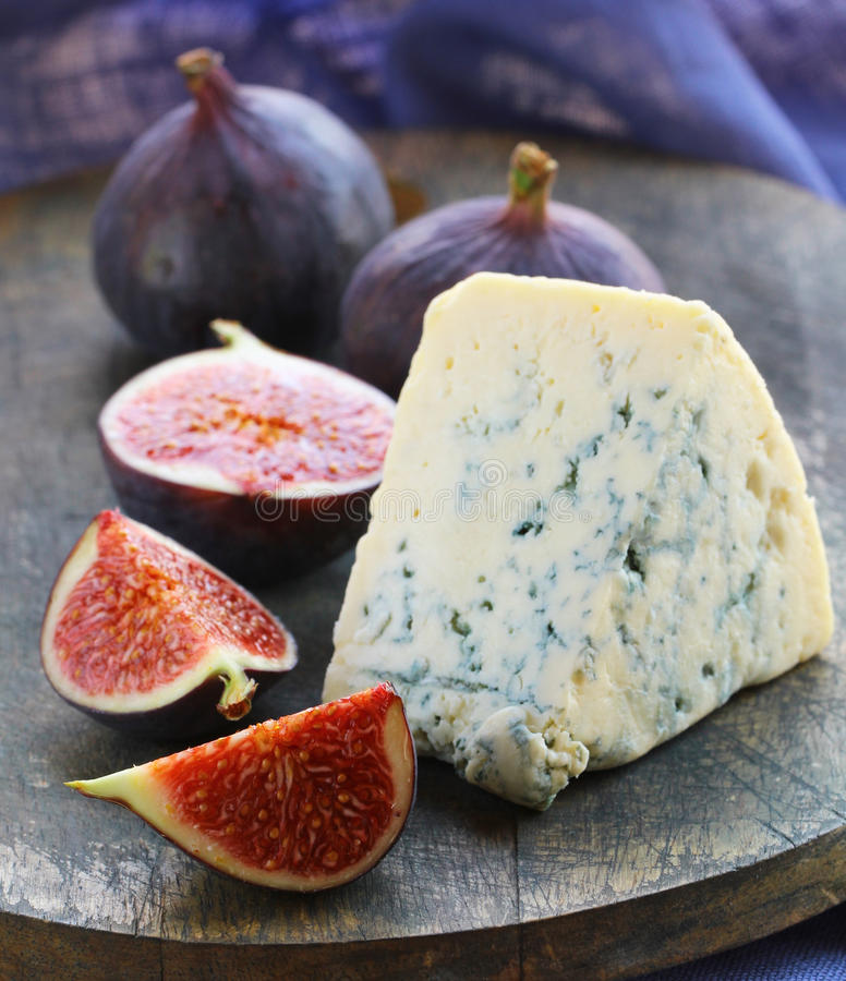 Delicatessen cheese appetizer with fruit stock photography