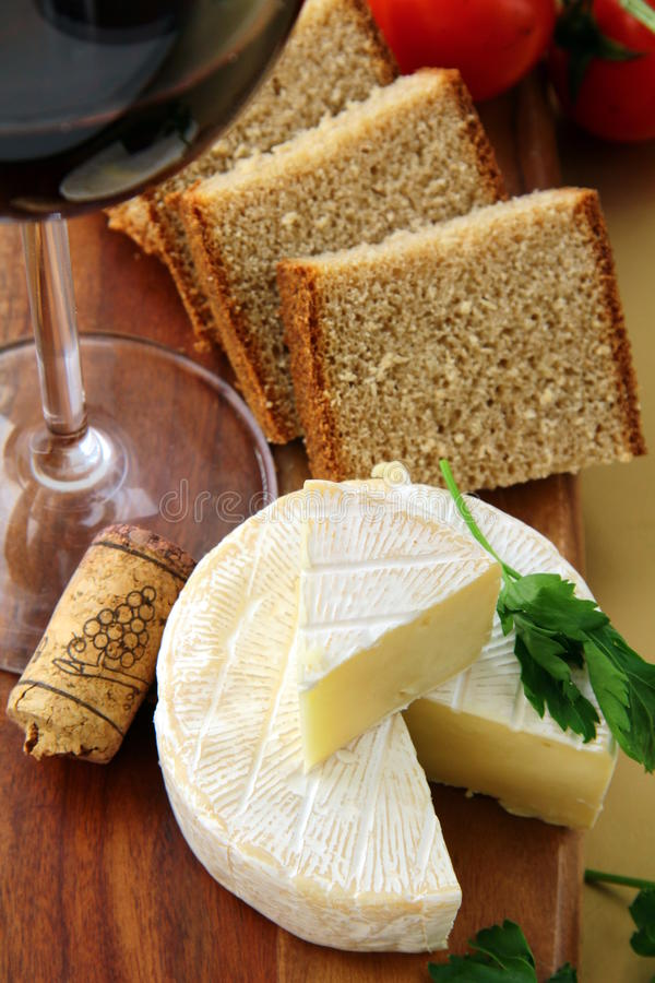 Delicatessen soft cheese with bread, tomatoes