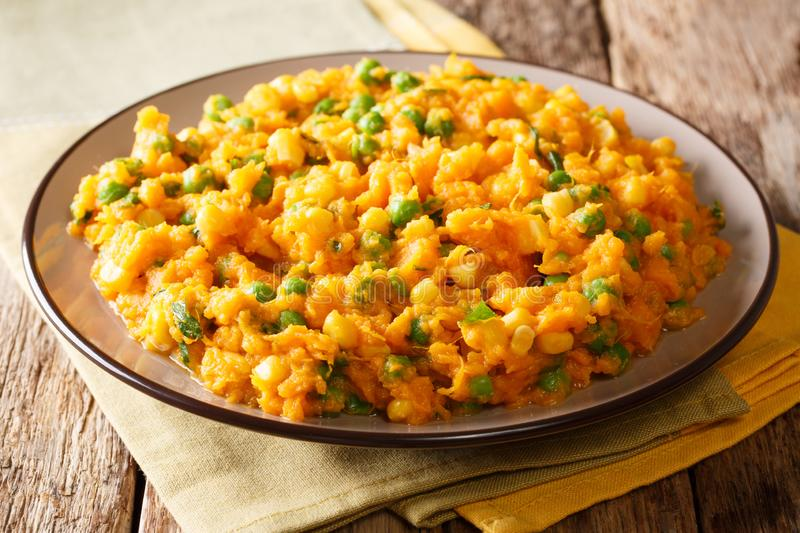 Delicious African food Irio spicy puree of sweet potato with green peas and corn close-up on a plate. horizontal stock photos
