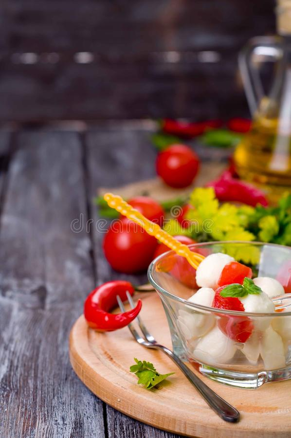 Delicious appetizer caprese. Delicious appetizer with boccocini, cherry tomatoes and basil or caprese royalty free stock photo