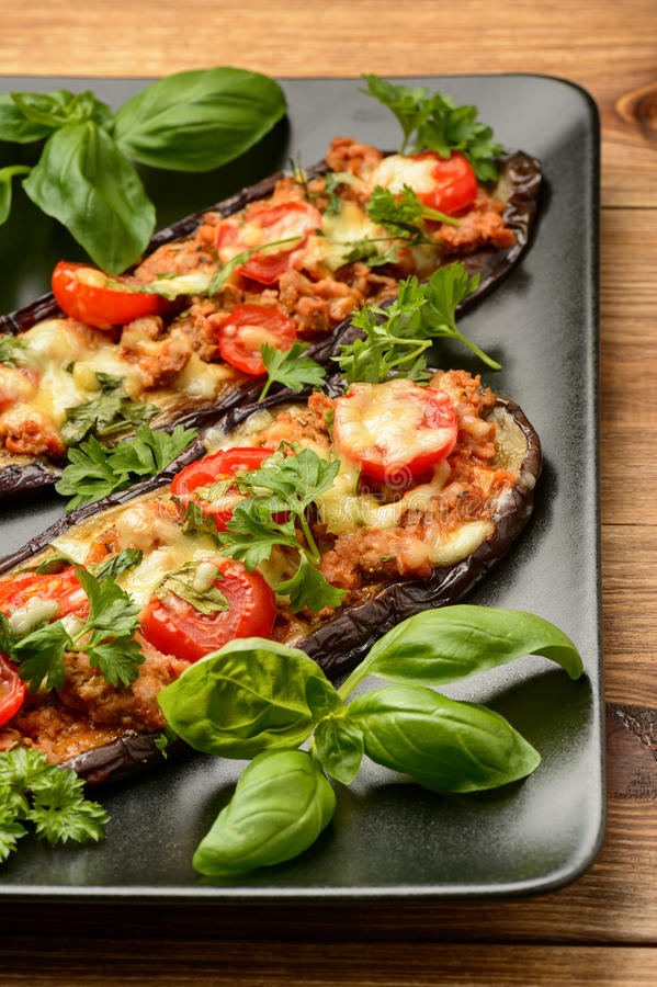 Delicious appetizer -grilled eggplants baked with minced meat, tomatoes and cheese. royalty free stock images