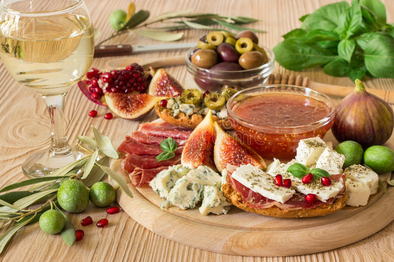 Delicious appetizer for wine on wood board. stock image