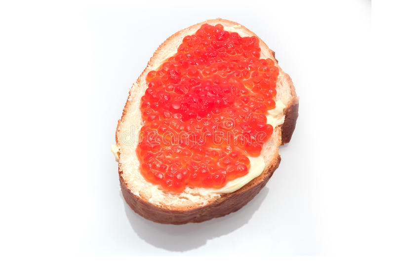 Delicious appetizing sandwich with red caviar. On white background stock photos