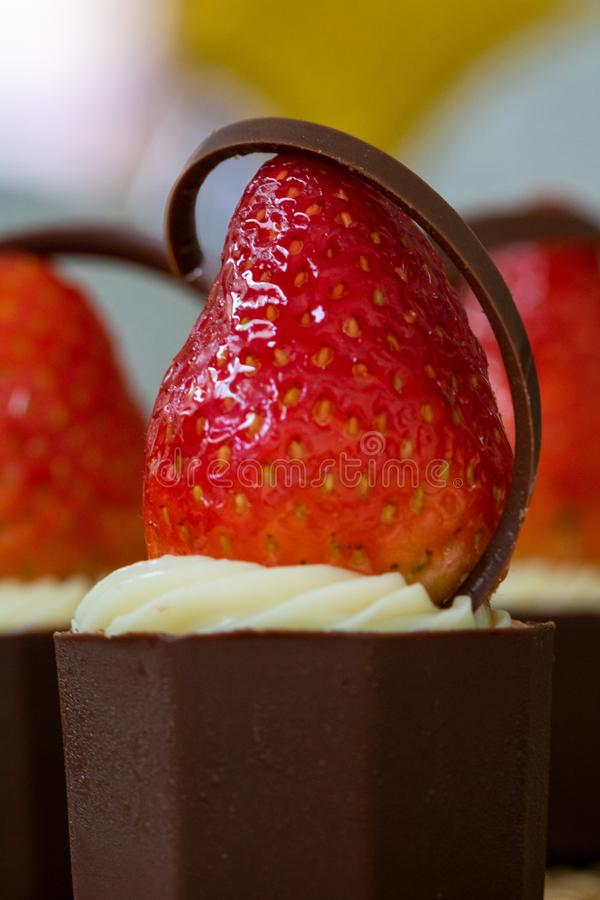 Delicious and appetizing Strawberry, cream and chocolate candy stock photo
