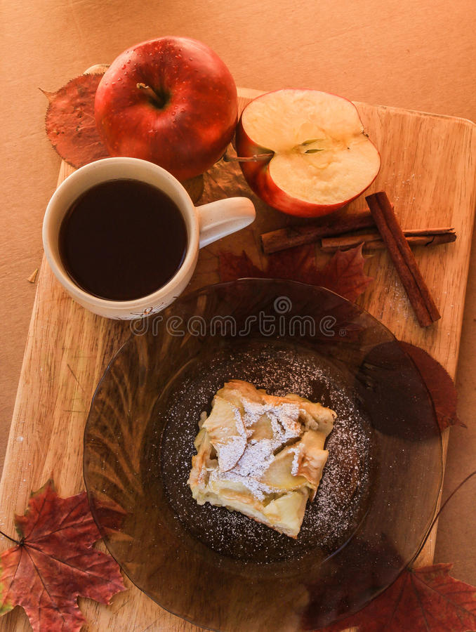 delicious apple dessert and a cup of tea royalty free stock photography