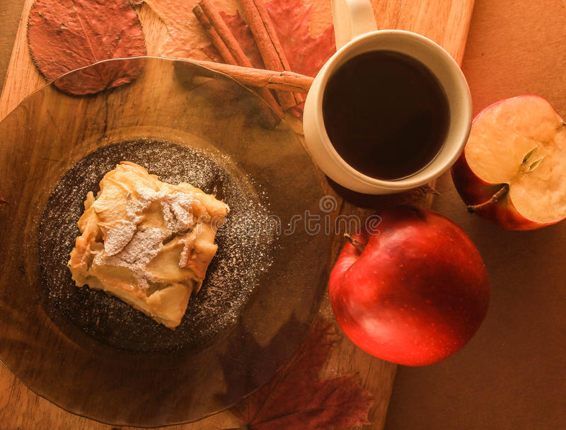 Delicious apple dessert and a cup of tea stock photos