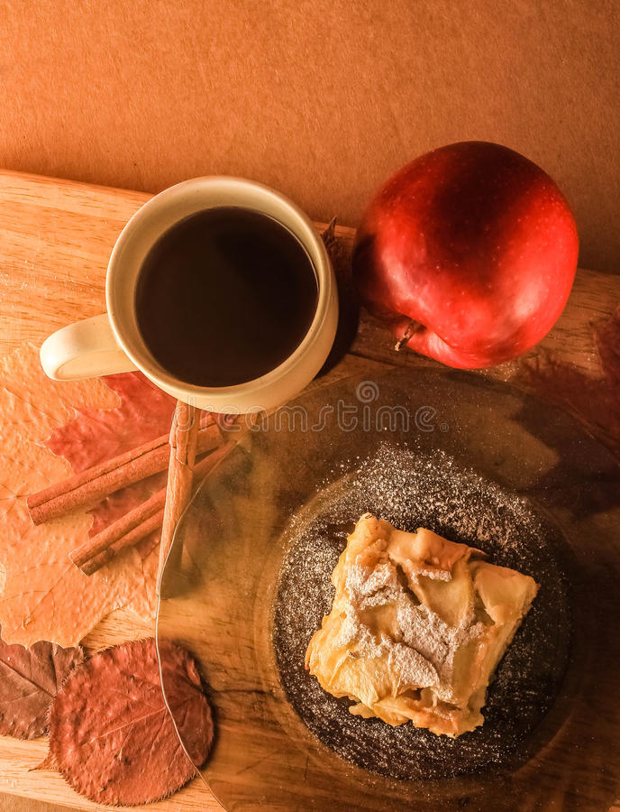 Delicious apple dessert and a cup of tea royalty free stock images