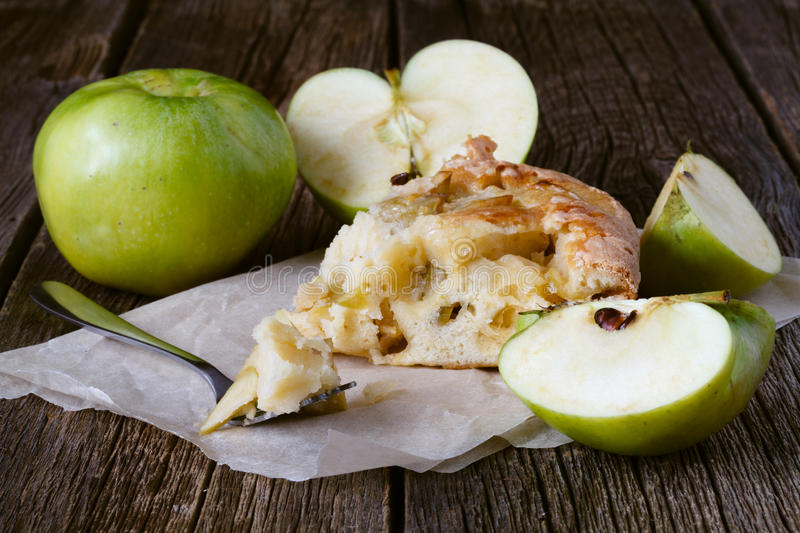 Delicious apple pie charlotte with caramel. Close up side view stock image