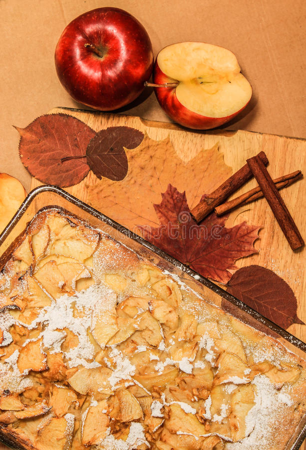 Delicious apple pie on a wooden board stock images