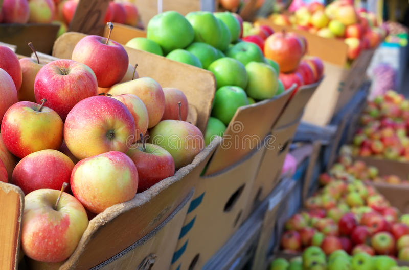 Delicious apples in the boxes on the market stock images