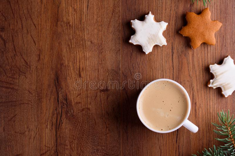 Delicious aromatic latte coffee on a wooden table with gingerbread royalty free stock photo