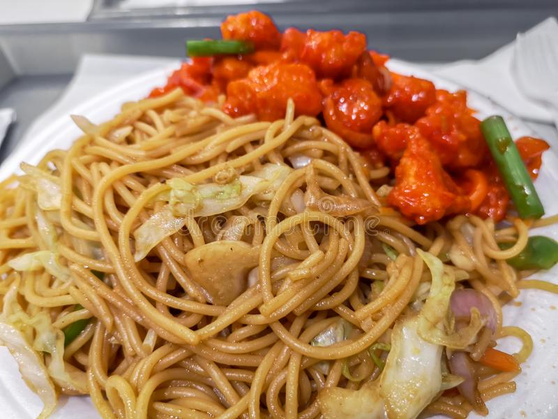 Delicious asian food - sweet and sour chicken and vegetables noodles stock images